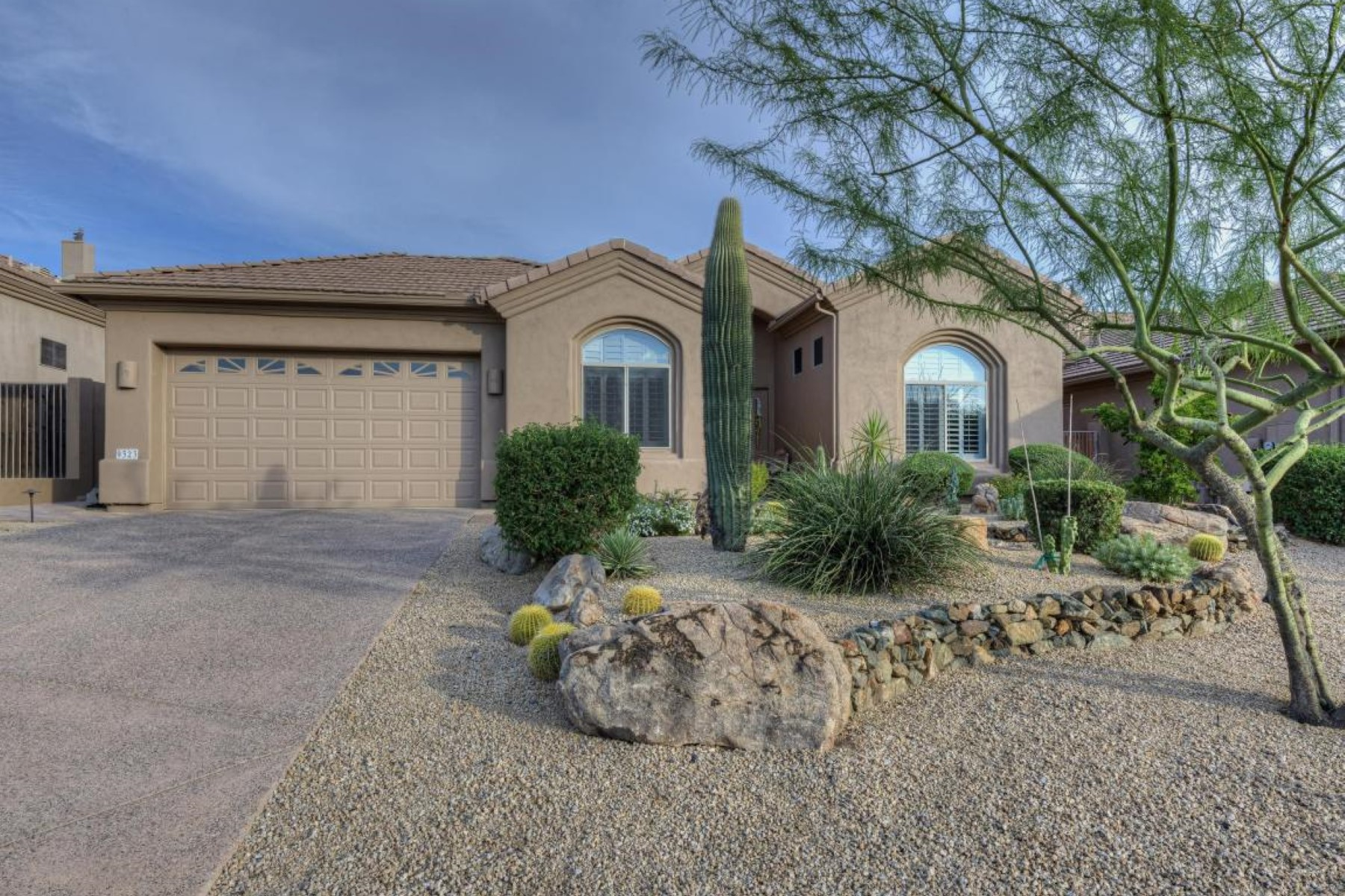 sales property at Beautiful home that overlooks lush desertscape to the fairway beyond