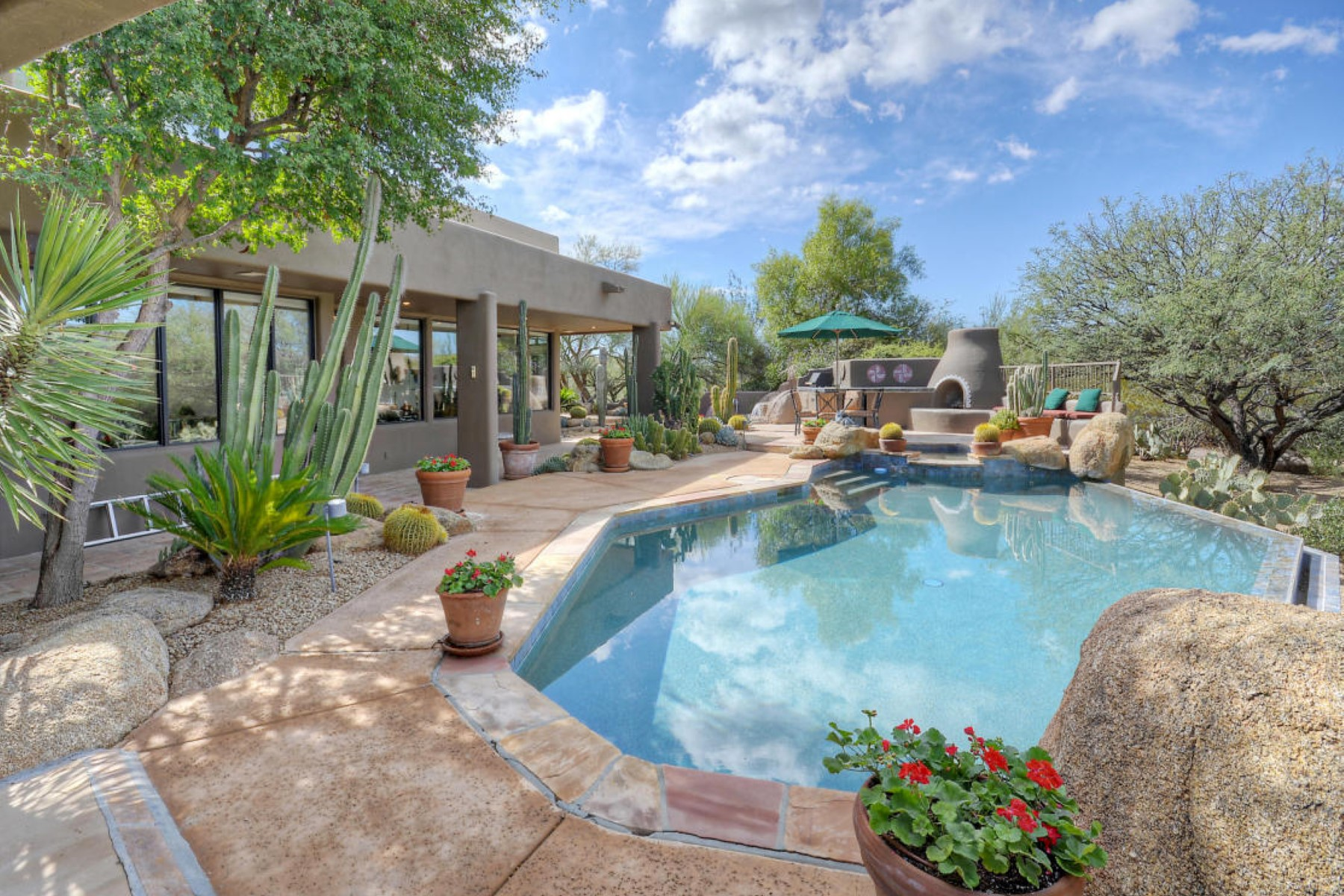 Single Family Home for Sale at Charming Boulders home located on 17th fairway of the N course 34766 N Indian Camp Trl Scottsdale, Arizona, 85266 United States