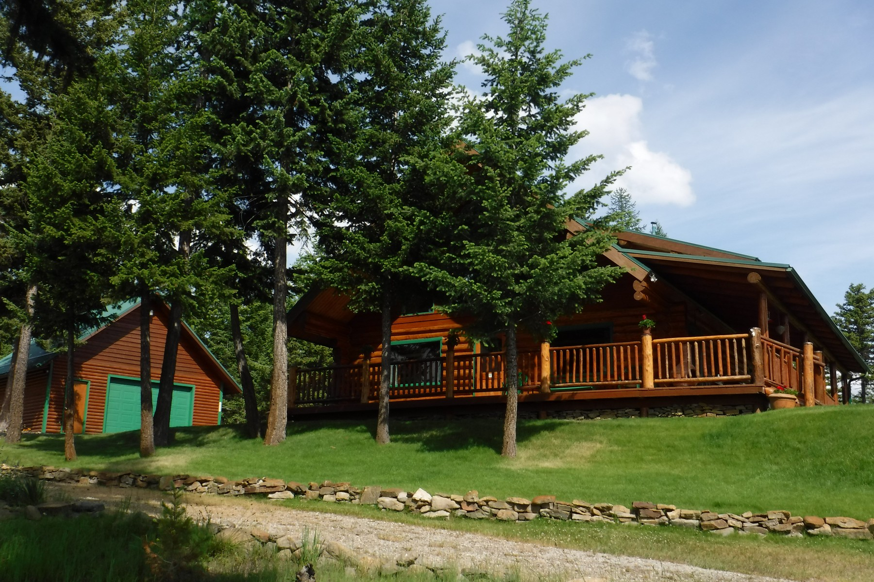 Property For Sale at Log Home with Open Floor Plan