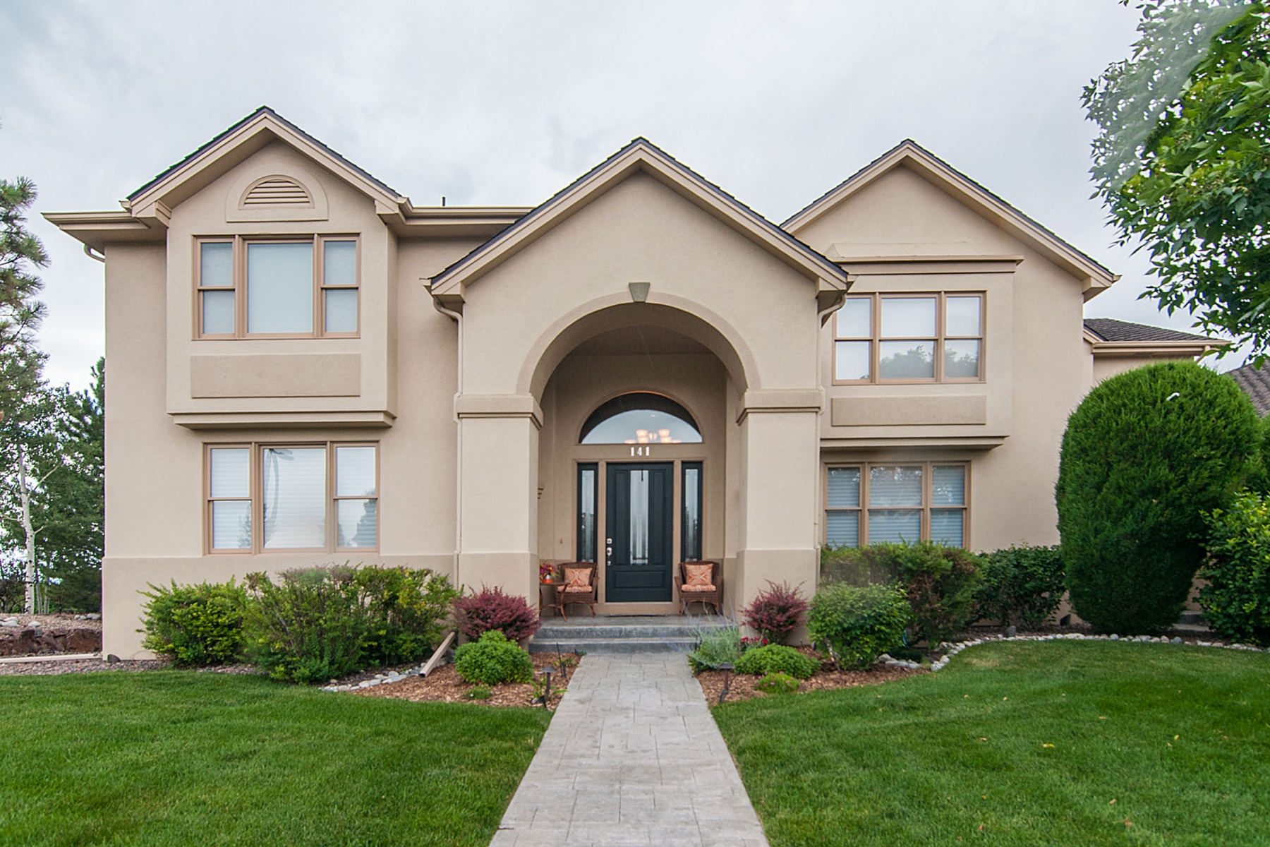 Single Family Home for Sale at Gracefully poised home with great Mountain Views 141 Fairchild Pl Highlands Ranch, Colorado 80126 United States