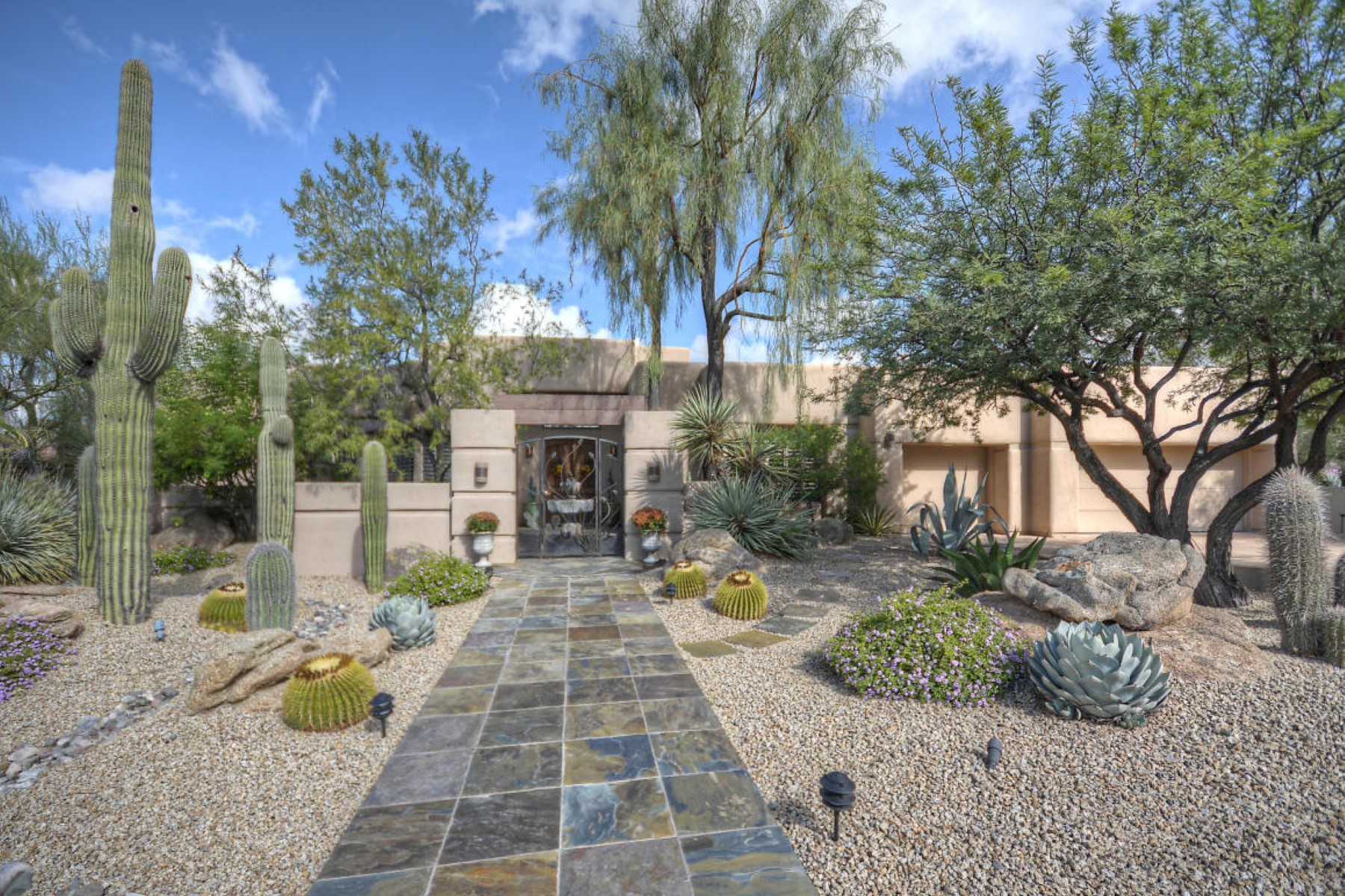 Single Family Home for Sale at Courtyard features charming custom ironwork gate and bubbling fountain 7448 E Thorntree Dr Scottsdale, Arizona 85266 United States