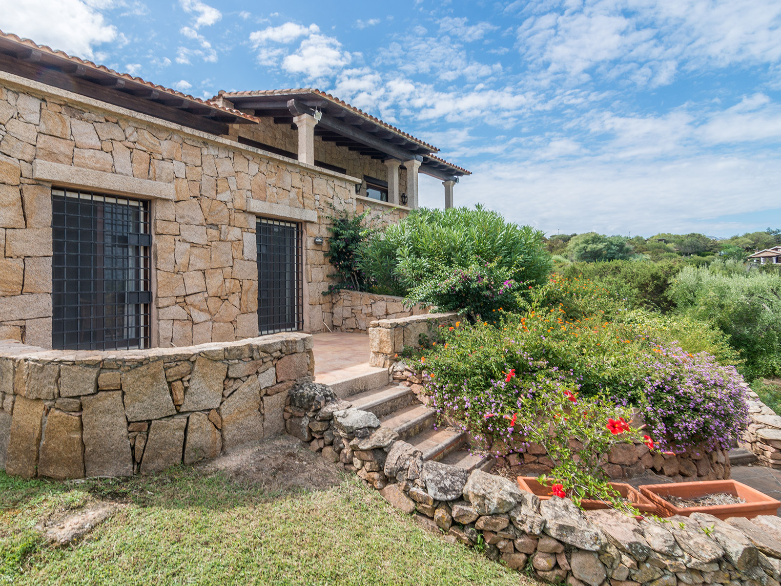 Single Family Home for Sale at Villa in Sardinian style with private garden Porto Rotondo, Olbia Tempio Italy