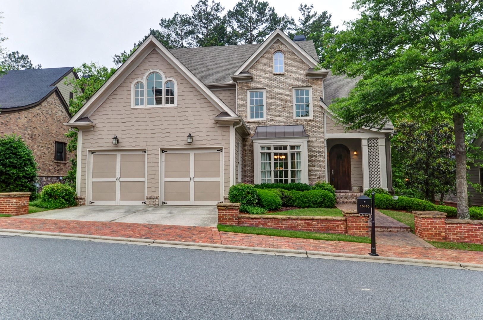 Single Family Home for Sale at Stately Home in a Charming Tree Lined Gated Community 10890 Carrissa Trail Alpharetta, Georgia 30022 United States