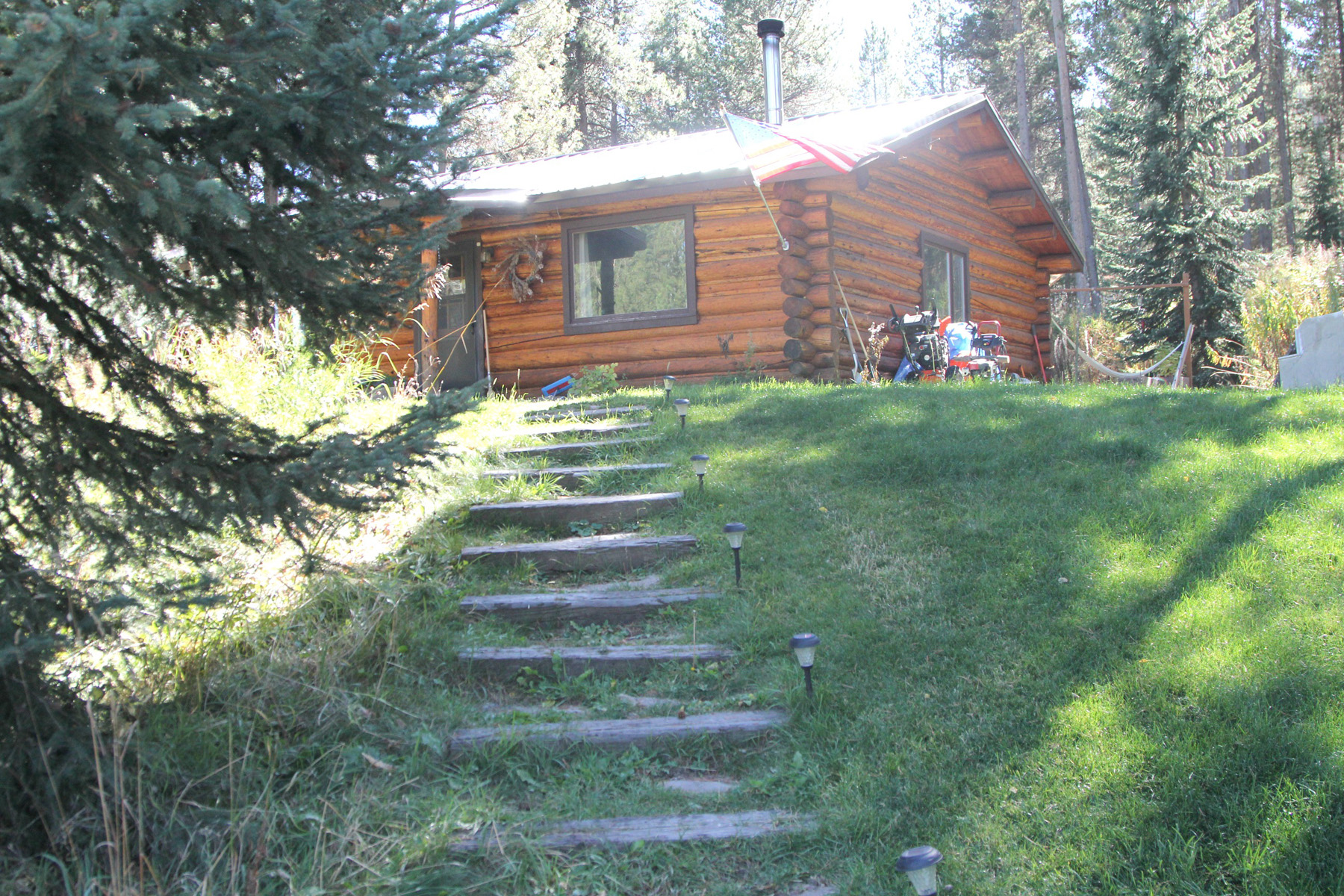 Property For Sale at Classic Log Cabin exudes JH Charm