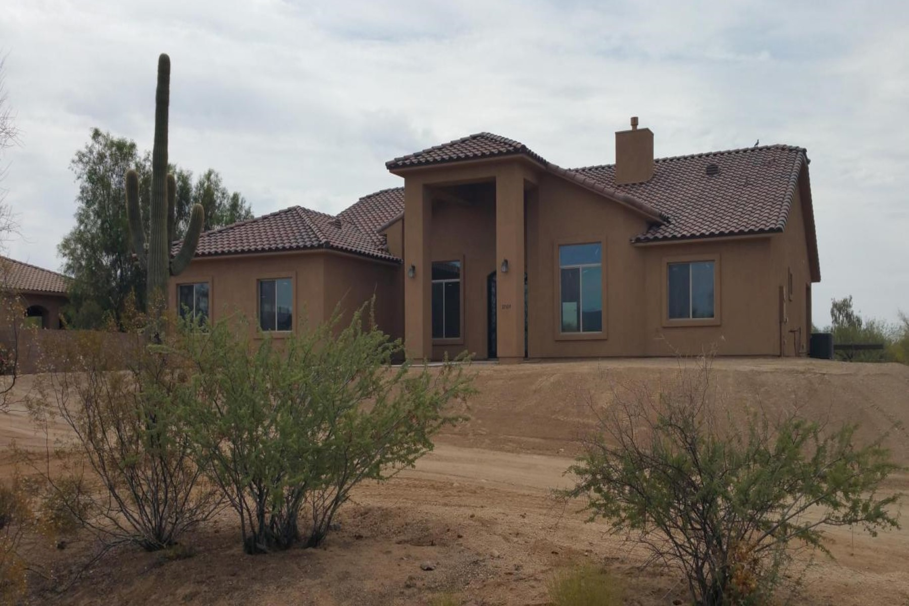 sales property at Beautiful elevated lot with natural desert front yard