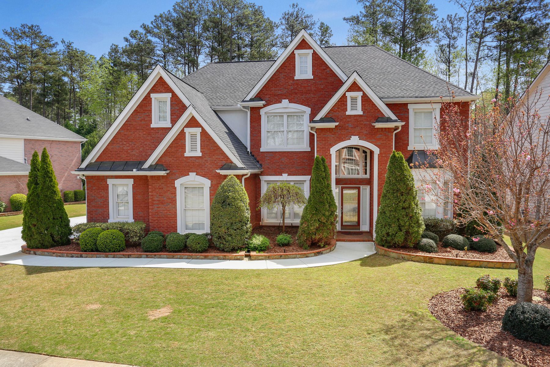 Casa Unifamiliar por un Venta en Beautifully Maintained Three-sided Brick Home 1045 Beacon Hill Crossing Alpharetta, Georgia, 30005 Estados Unidos