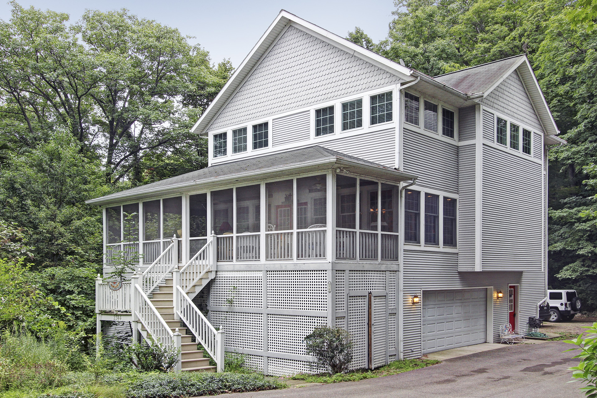 Single Family Home for Sale at Welcoming beach home 2344 Maksaba Trail Macatawa, Michigan, 49434 United States