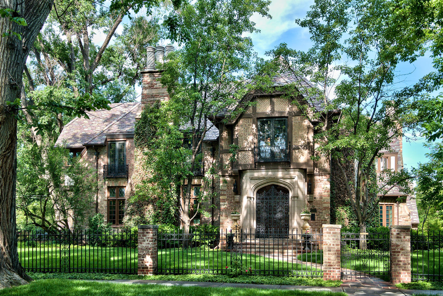 Single Family Home for Active at Grand 1930's Ivy Covered Tudor Gracefully Poised Behind Wrought Iron Gates 177 N. Humboldt Street Denver, Colorado 80218 United States