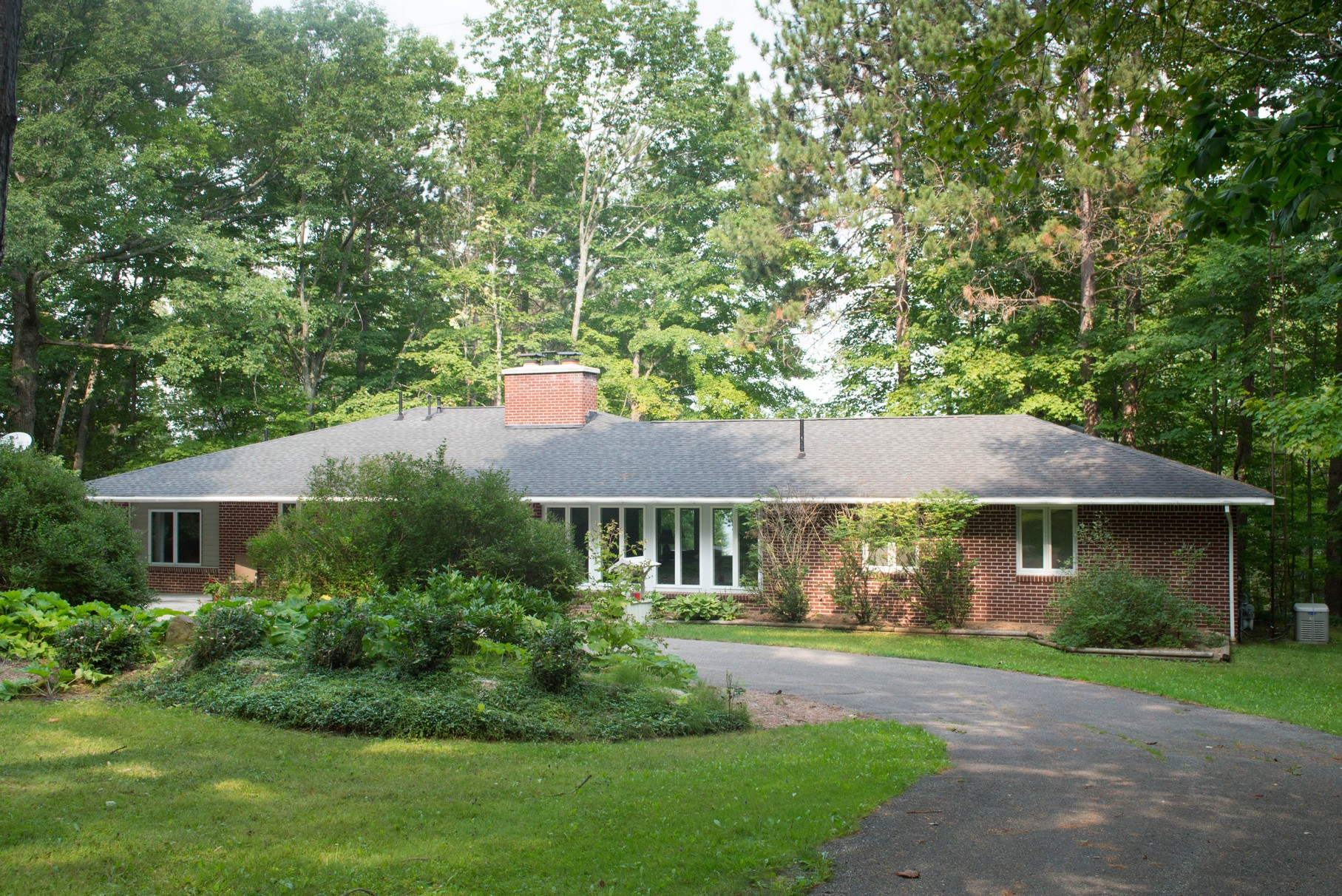 sales property at Mid-Century Modern Executive Home on Burt Lake