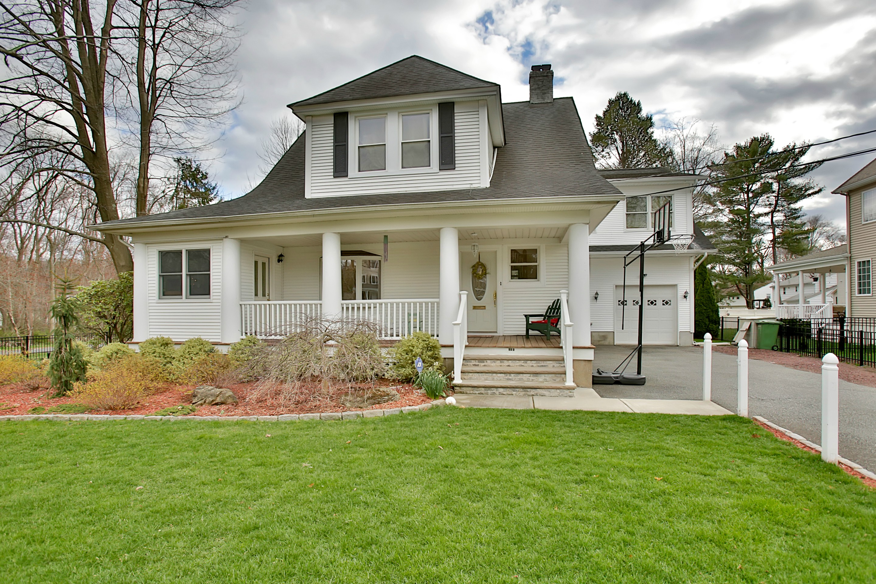 sales property at Manicured Country Colonial With Old World Charm.