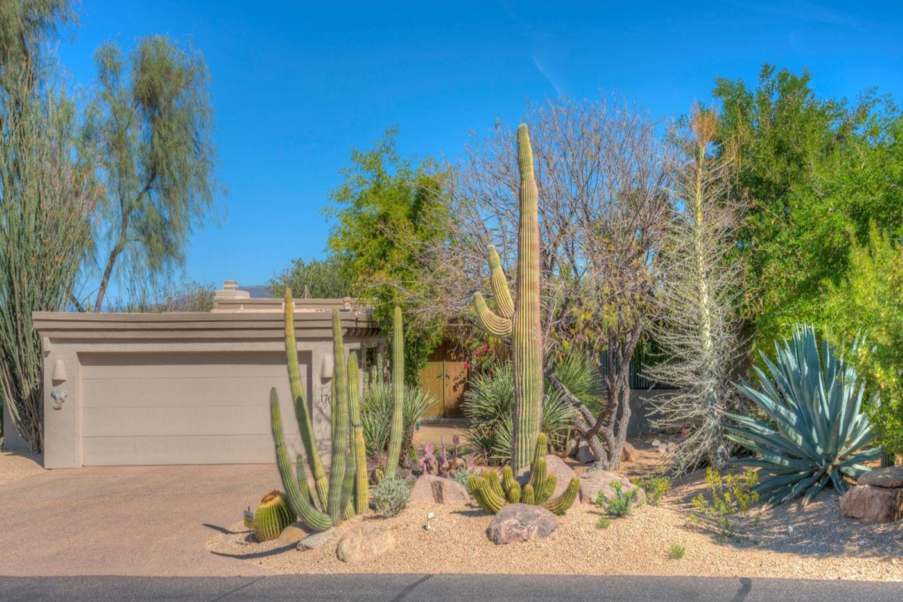 sales property at Southwest residence tucked away in The Boulders