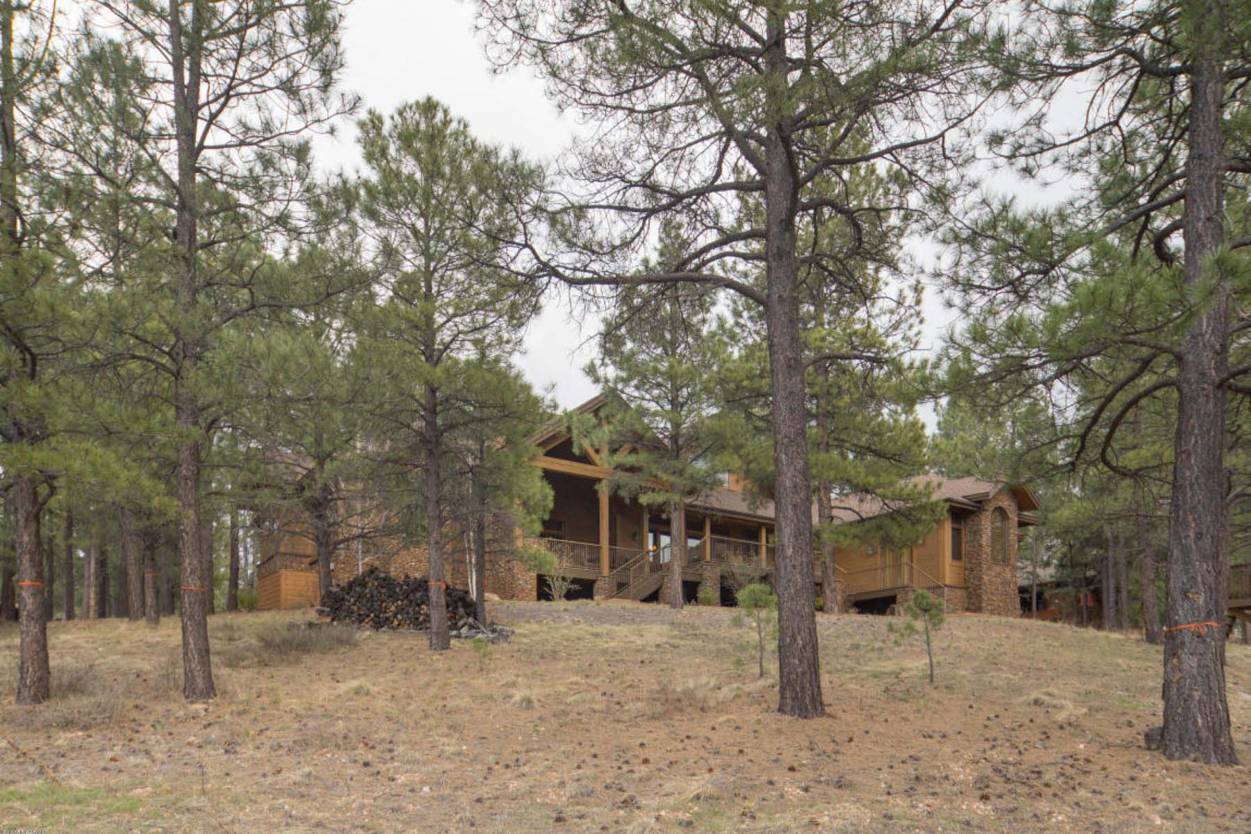 Single Family Home for Sale at Stunning mountain retreat in the community of Forest Highlands Golf Club. 2098 Cecil Richardson Flagstaff, Arizona 86005 United States