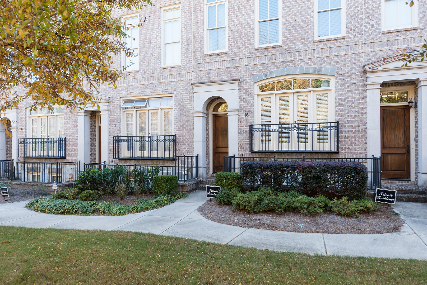 Property For Sale at Sophisticated Brick And Stone Townhome