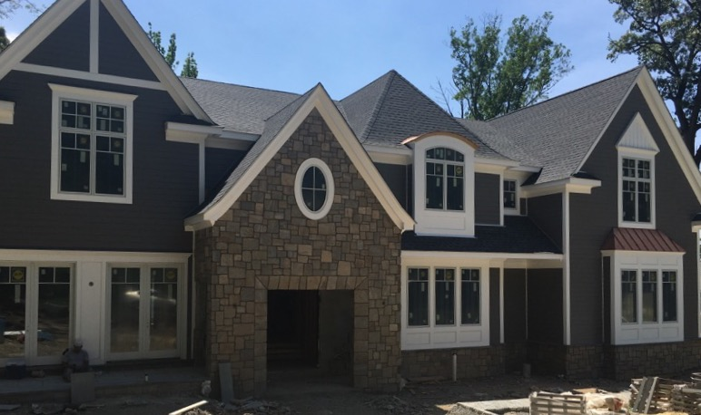 sales property at Magnificent New Construction on the East Hill!