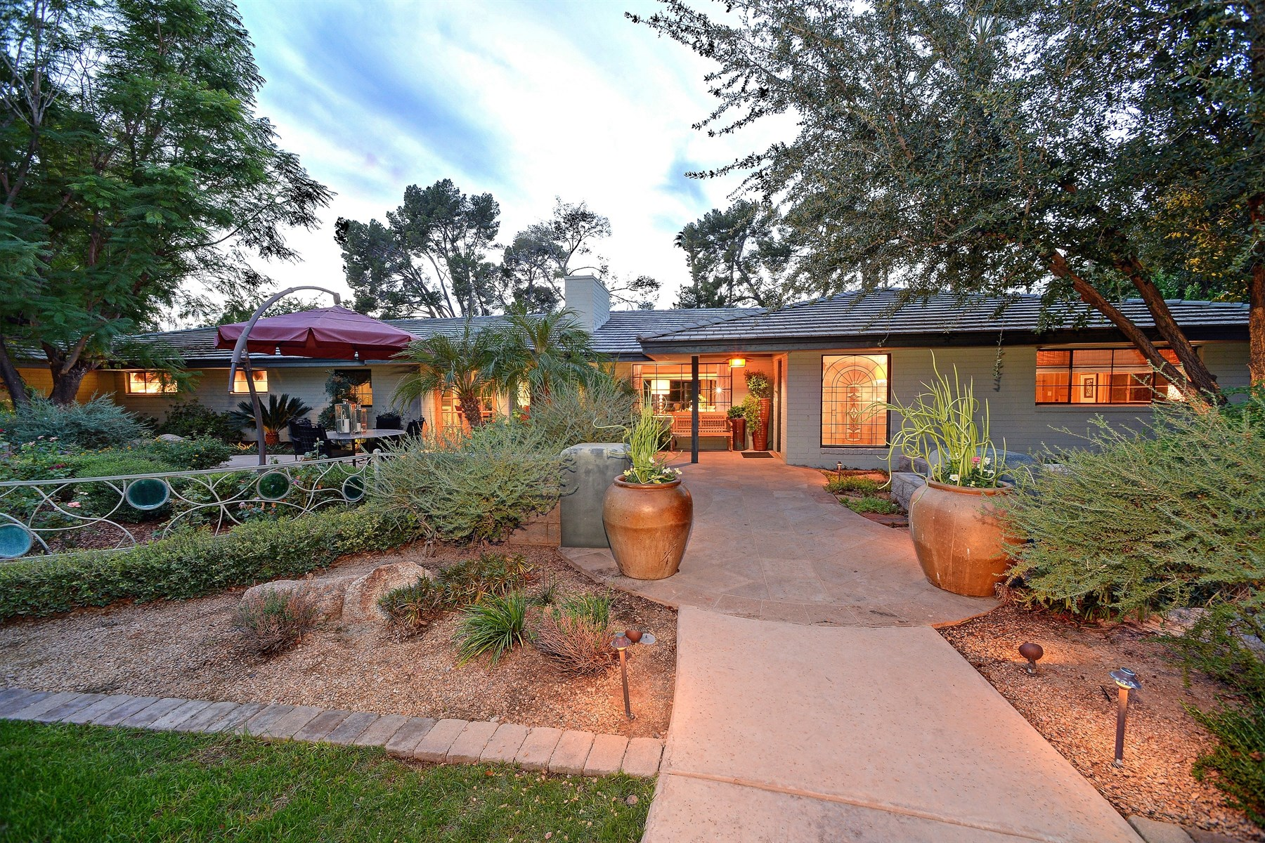 Property For Sale at family-friendly home in the exclusive gated community of Phoenix County Club