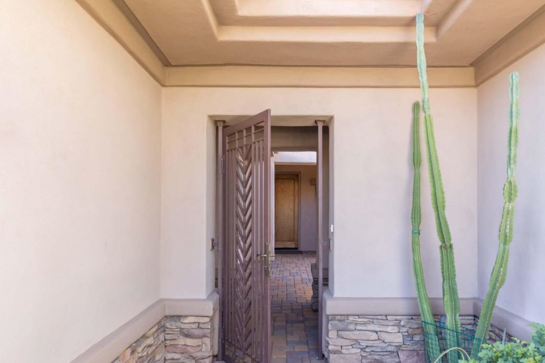 Property Of Fully furnished home with private gated courtyard