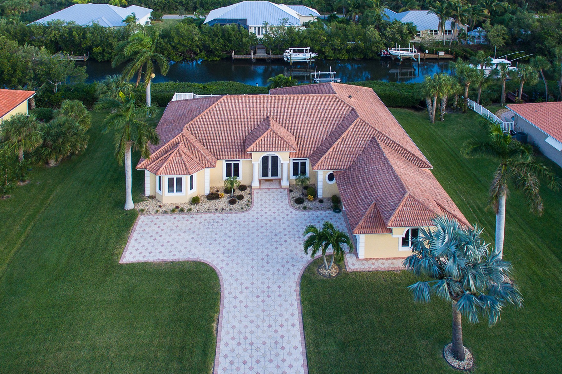 Single Family Home for Sale at Gorgeous Canal Front Home 2146 Harbor Ln Vero Beach, Florida, 32963 United States