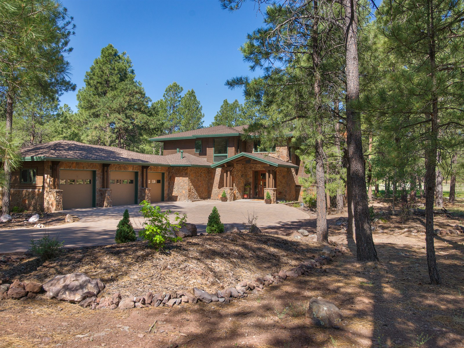 Single Family Home for Sale at Gorgeous Multi-Level Forest Highlands Craftsman home. 1780 Bessie Kidd Best Flagstaff, Arizona 86001 United States