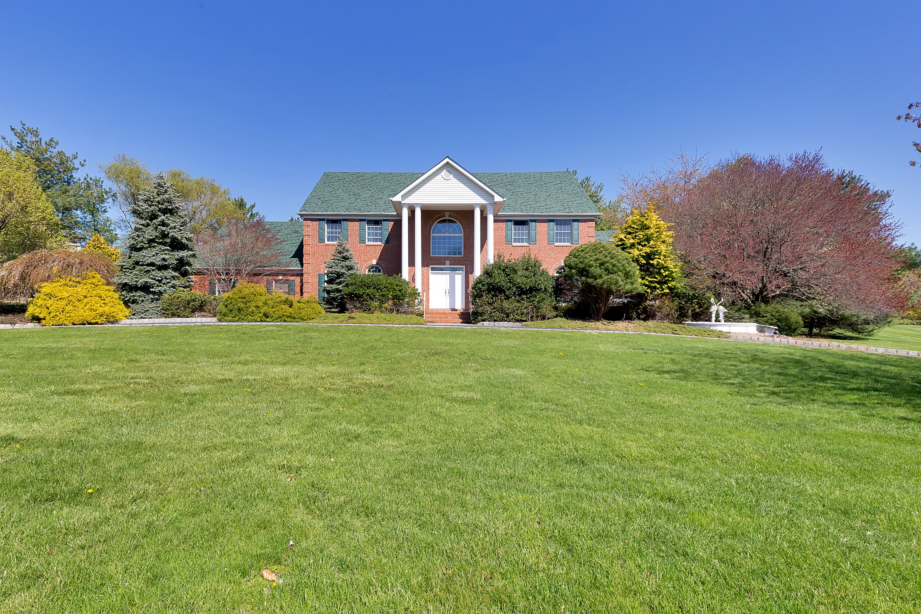 sales property at Stately Brick Front Colonial