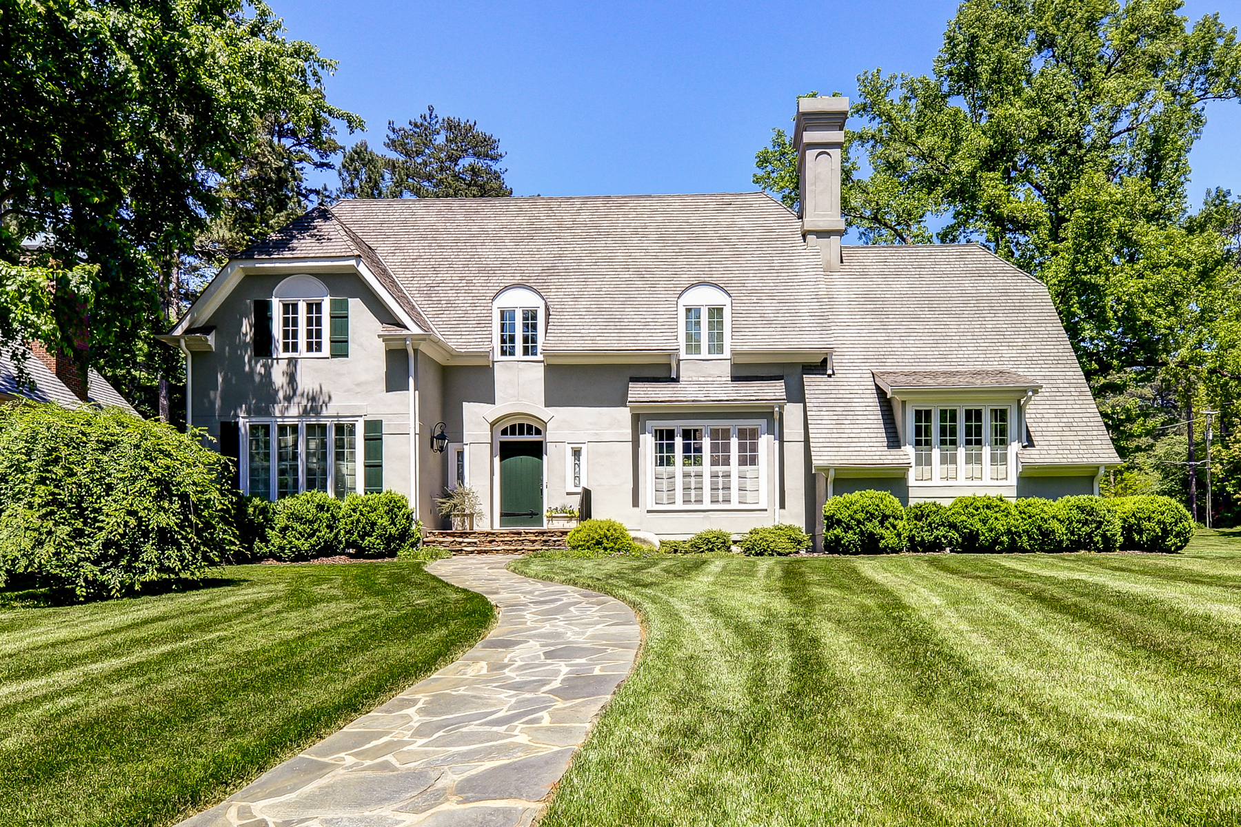 Property For Sale at Cozy European Elegance in Charming Historic Brookhaven Setting