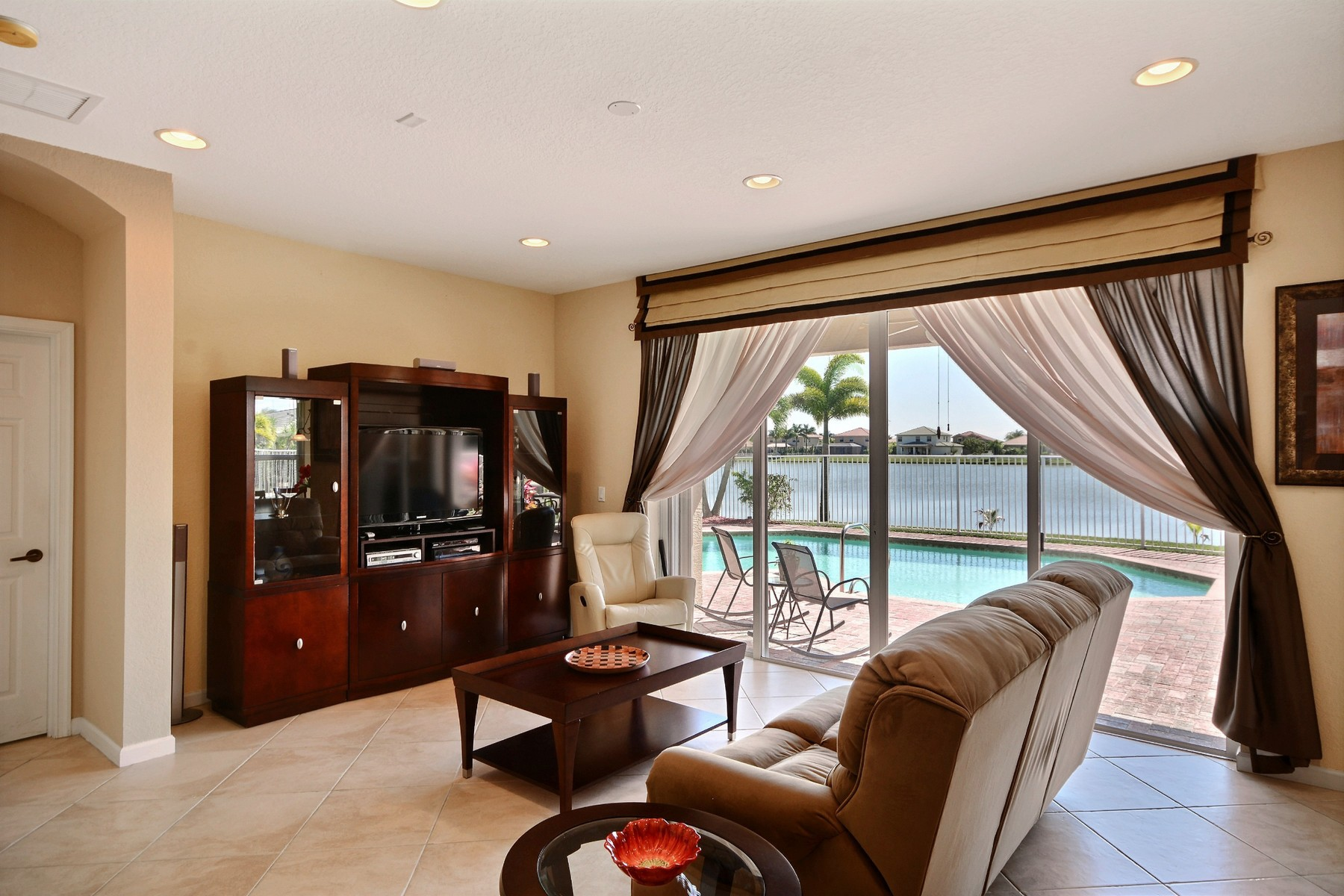 Single Family Home for Sale at Gorgeous lakefront Pool Home in Diamond Lake 5205 Sapphire Ln SW Vero Beach, Florida, 32968 United States