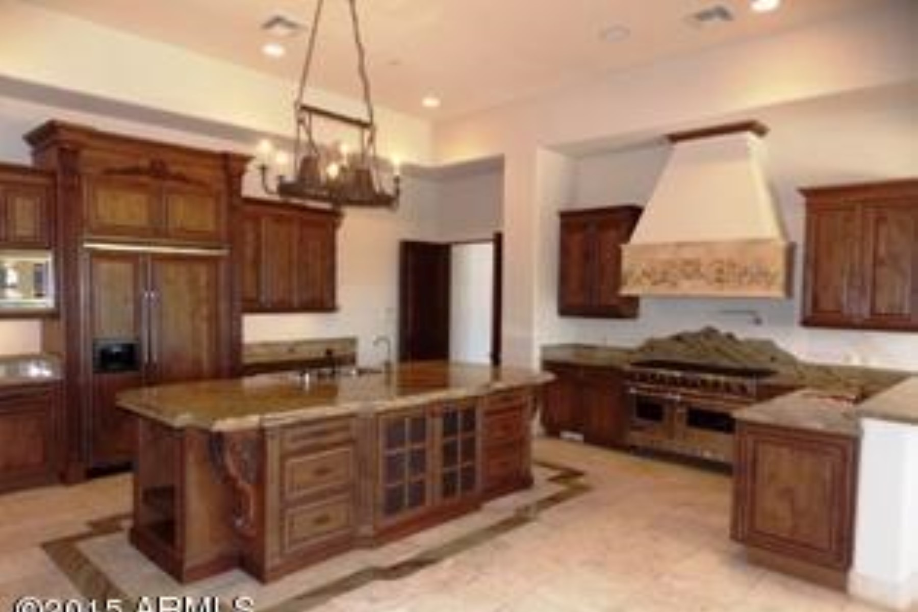 Property For Sale at Tuscan style home with the most desirable finishes.