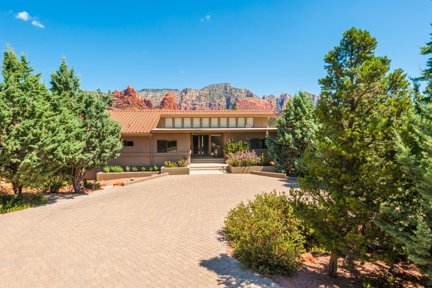 Property For Sale at Redesign of the home with an emphasis on revealing Sedona's most coveted views