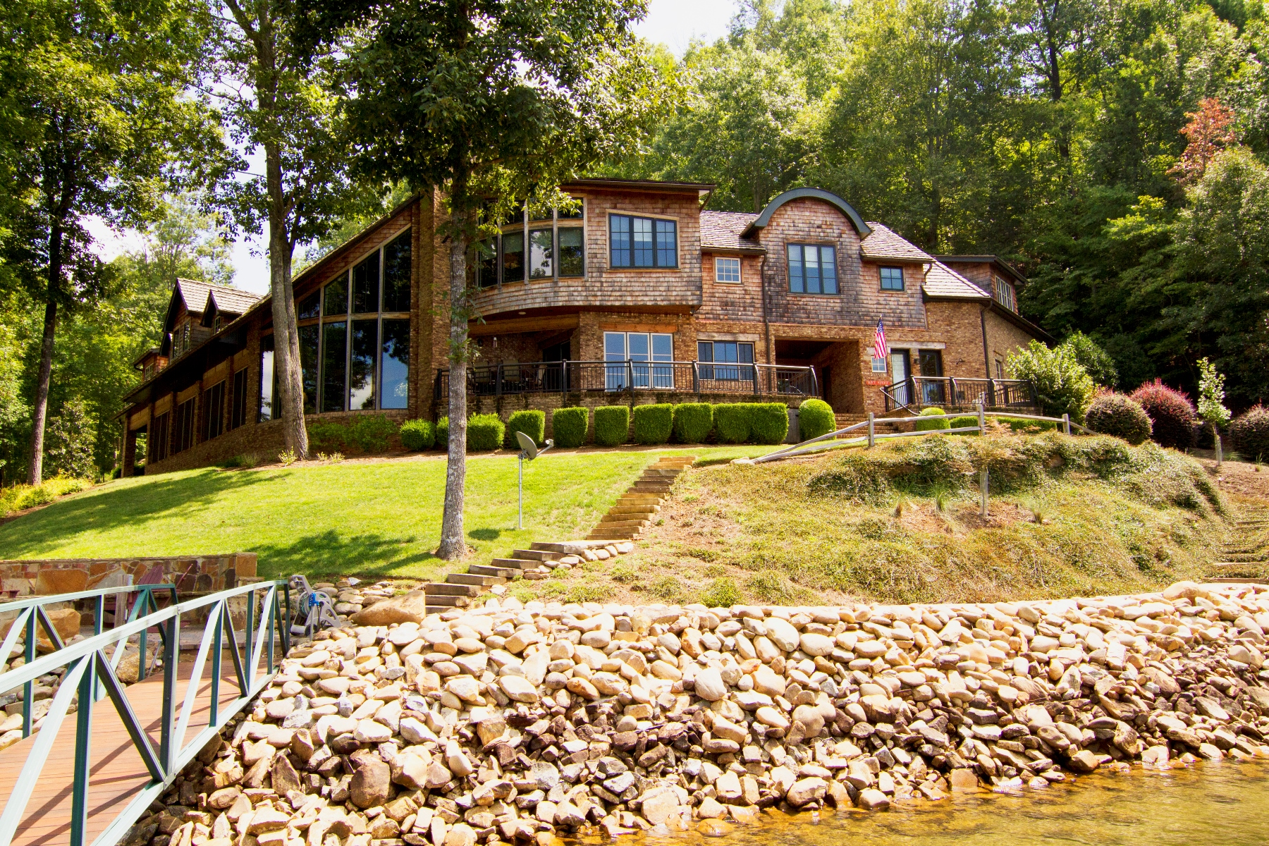 Single Family Home for Sale at Captivating Architectural Masterpiece on a Magnificent Semi-point Waterfront Lot 5 N. Turtle Rock Road + C2-51 The Reserve At Lake Keowee, Sunset, South Carolina, 29685 United States