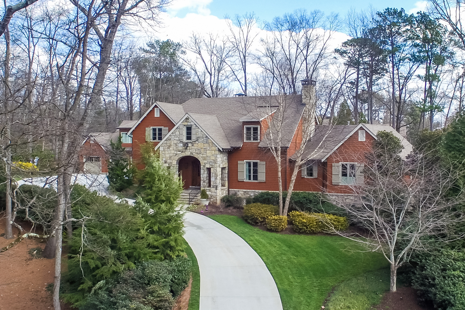 sales property at Exceptional Custom Home Nestled In A Beautiful Wooded Setting