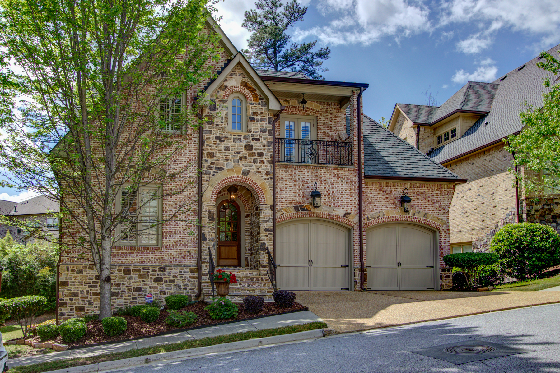 sales property at Immaculate Brick and Stone Executive Home in Charming Brookhaven Setting