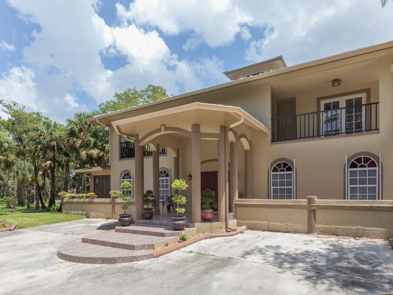 Maison unifamiliale pour l Vente à 1154 Gallop Drive Loxahatchee, Florida 33470 États-Unis
