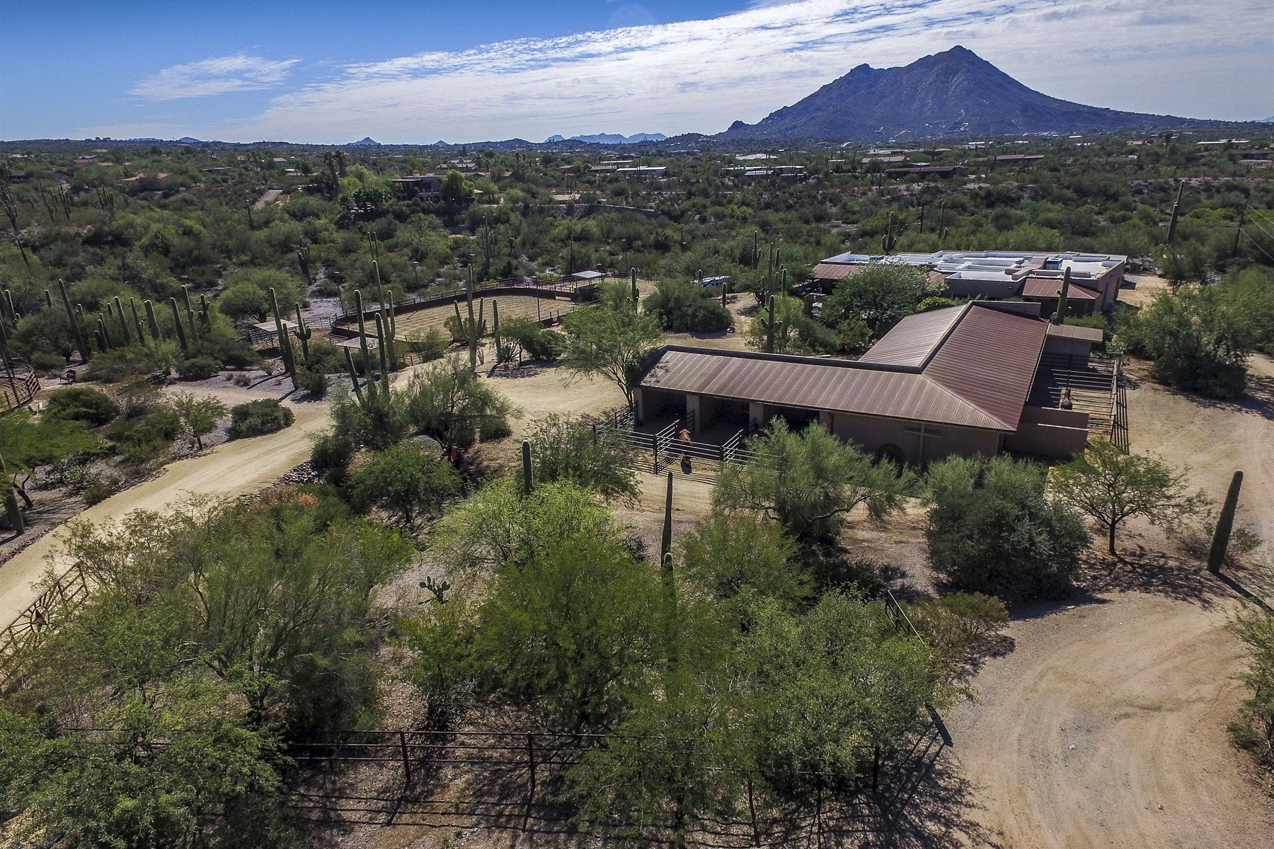 sales property at Picturesque gated ranch has panoramic mountain views