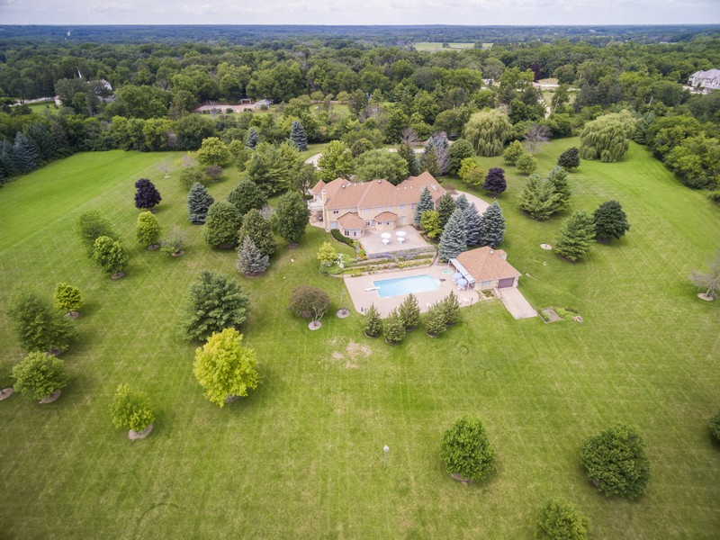 Single Family Home for Sale at Stately Stone Estate Sits Proudly On 16 Lush Acres 215 Dundee Road Barrington Hills, Illinois, 60010 United States