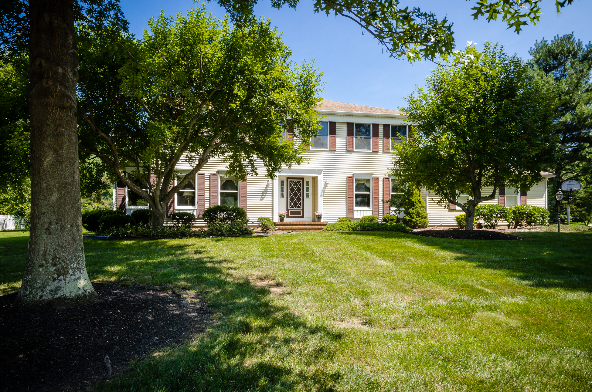 Property For Sale at Classic Colonial Home Surrounded by Towering and Majestic Oak Trees