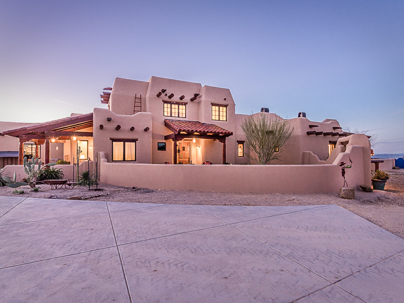 sales property at Authentic Pueblo Style Home with Stunning Ridge Top Views