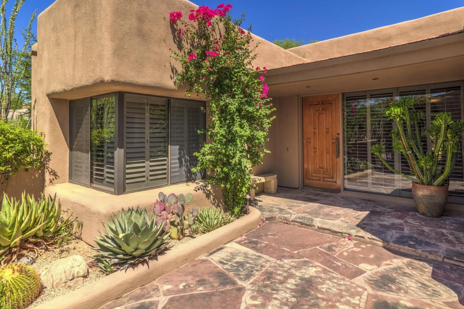 Property For Sale at Gorgeous Santa Fe style home boasts a world class Boulders community