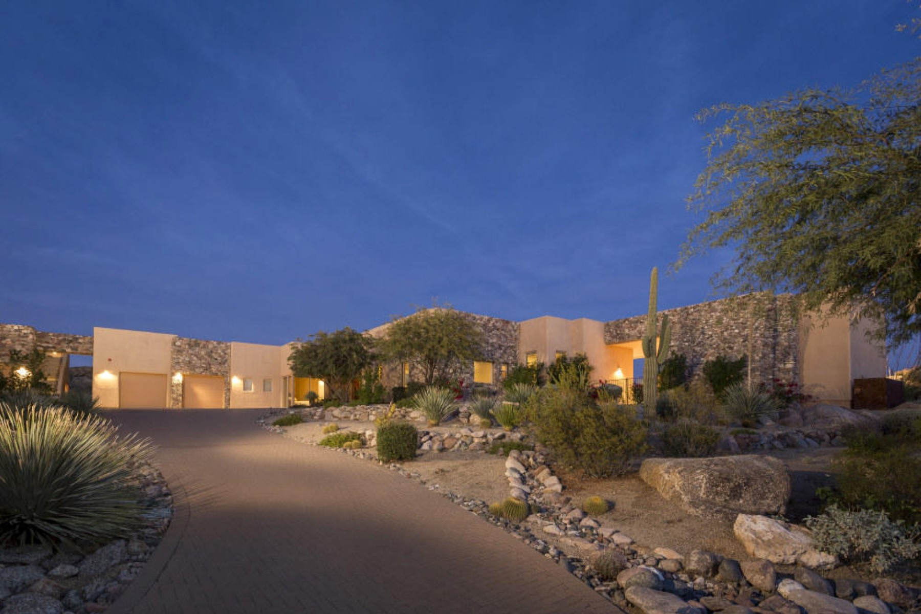 Property For Sale at Exquisite residence begins with a dramatic setback on a 1.8 acre lot.