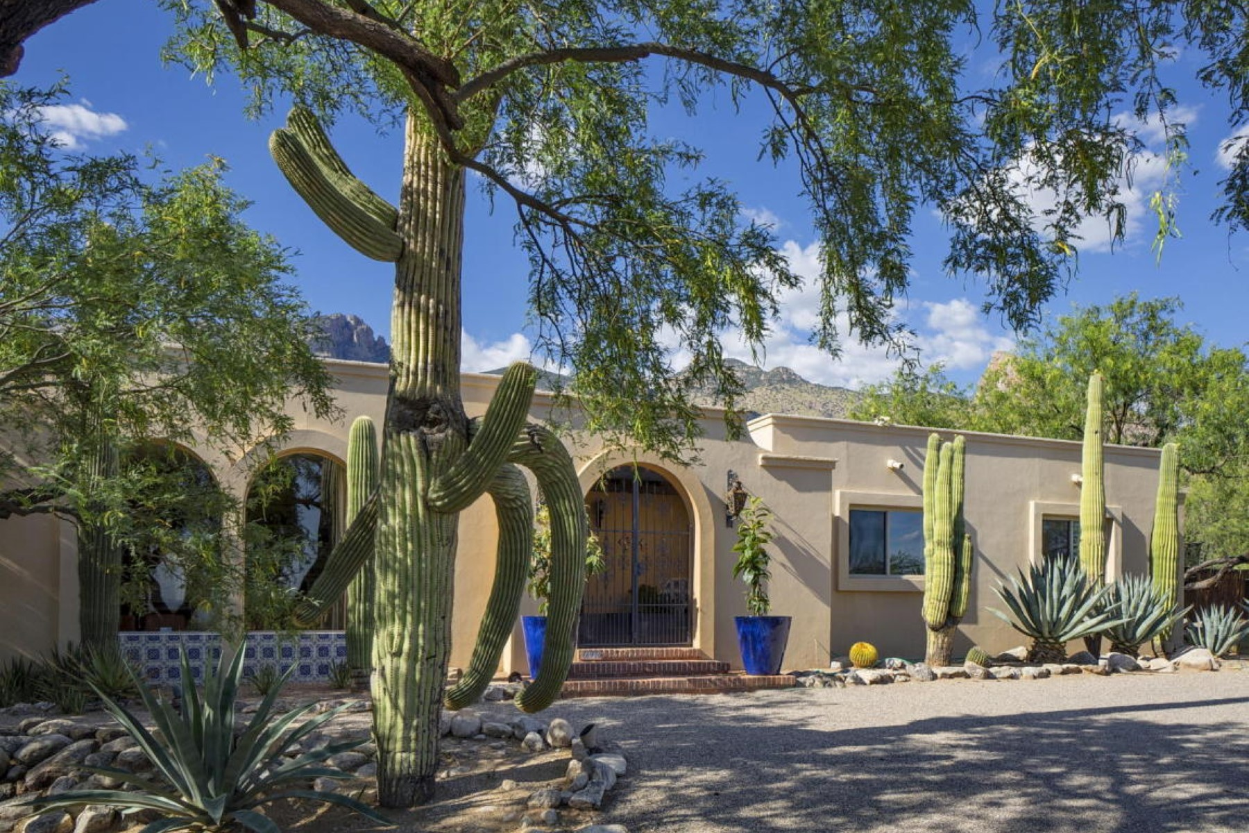 Single Family Home for Sale at Iron gates and fountain leads you to entry of this wonderful Foothills home. 6920 N Alvernon Way Tucson, Arizona 85718 United States