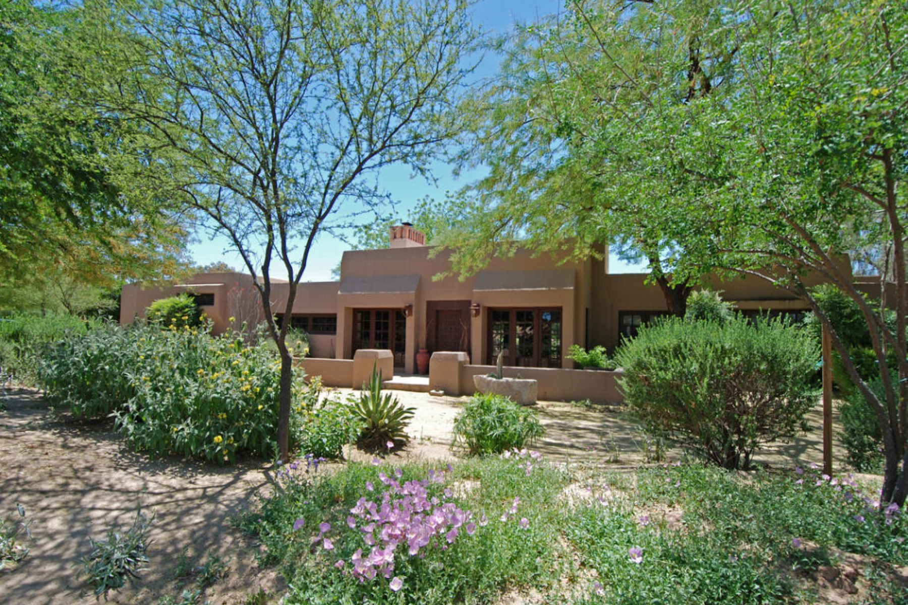 Property For Sale at Richly detailed, this high-fashion Southwestern home.