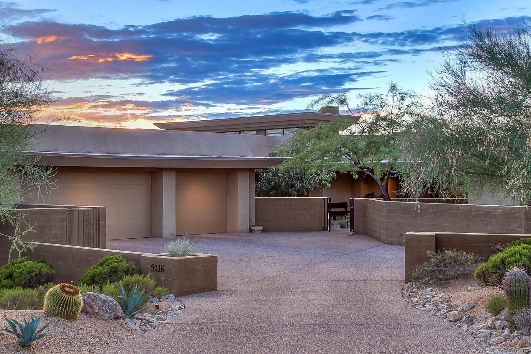 sales property at custom contemporary has five bedrooms, 4.5 baths including casita