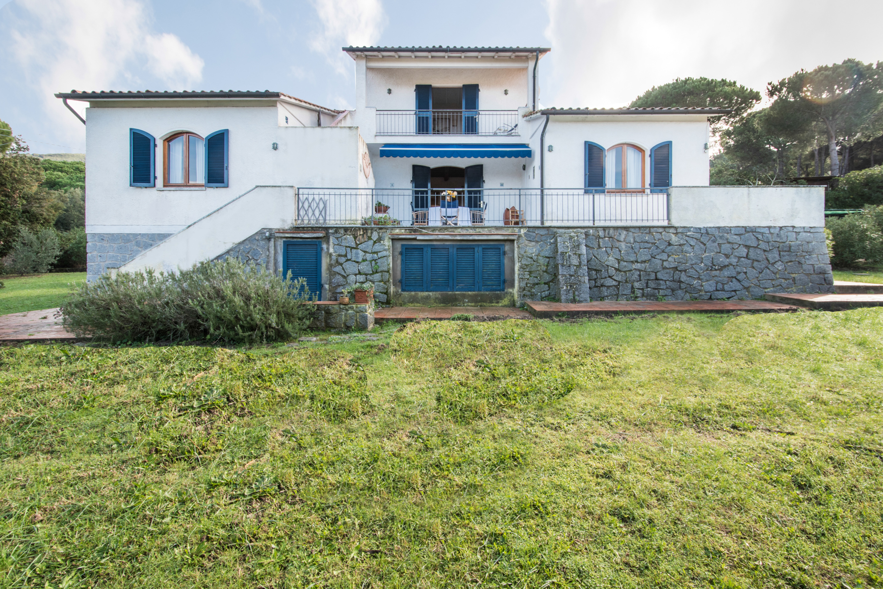 Single Family Home for Sale at Detached villa nestled within fenced garden Via di Campo all'Aia Marciana, 57033 Italy