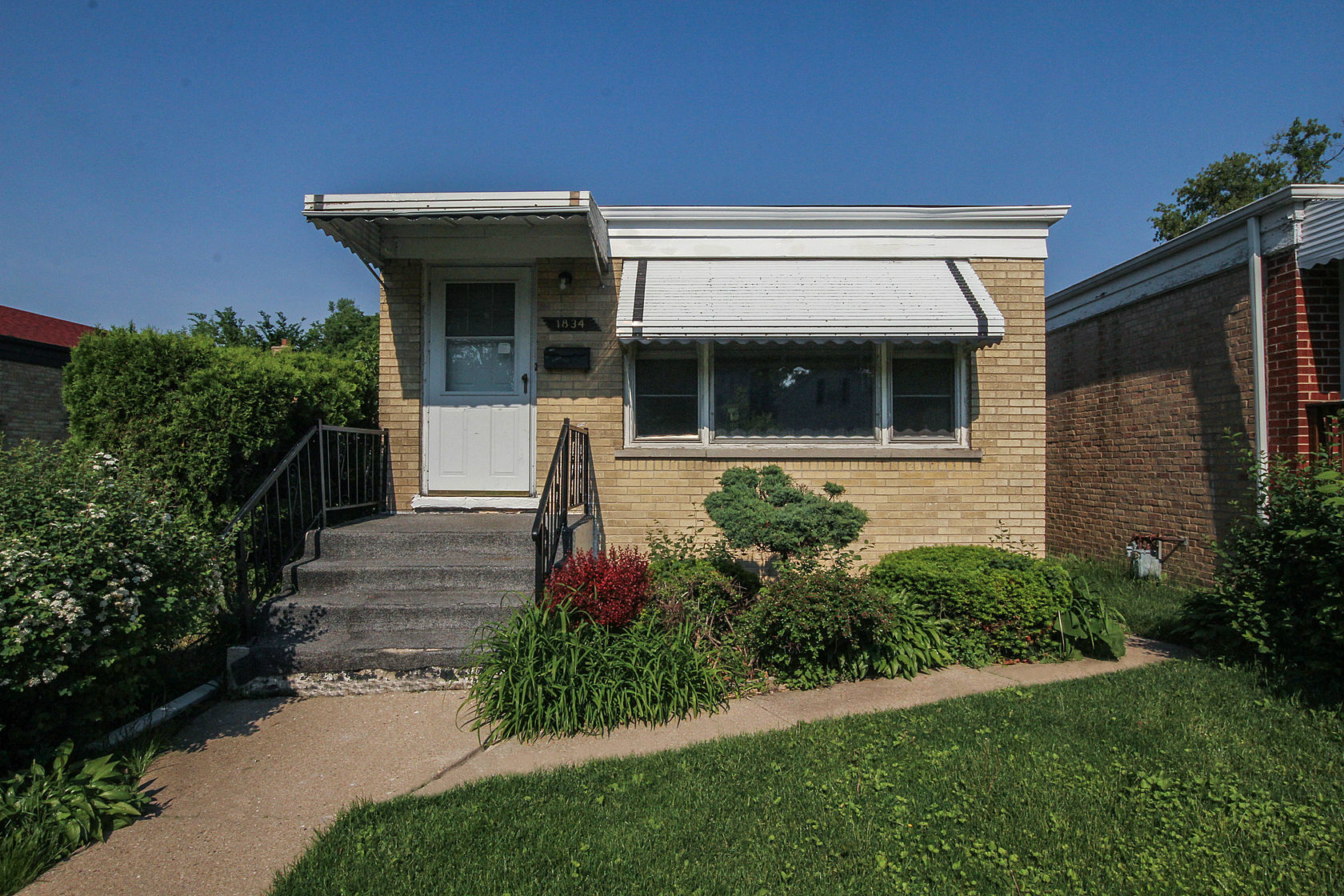 Property For Sale at Great Brick Bungalow!