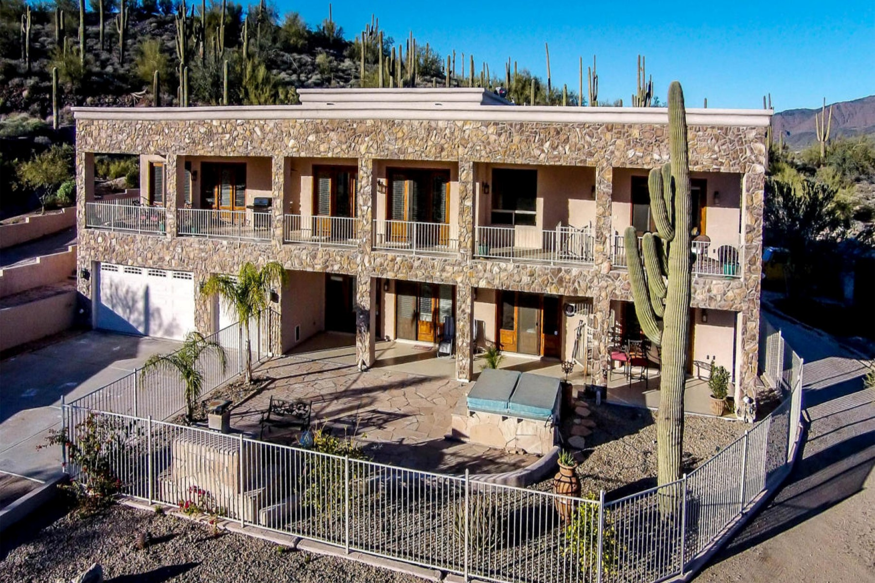 sales property at A residence designed around the views and lush upper Sonoran
