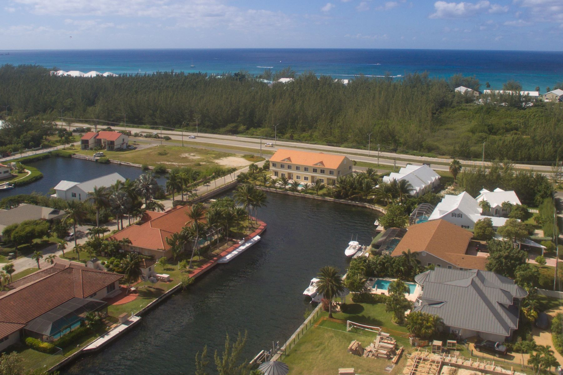 Single Family Home for Sale at Contemporary Canal front home Jellicoe Quay Governor's Harbour West Bay, KY1 Cayman Islands