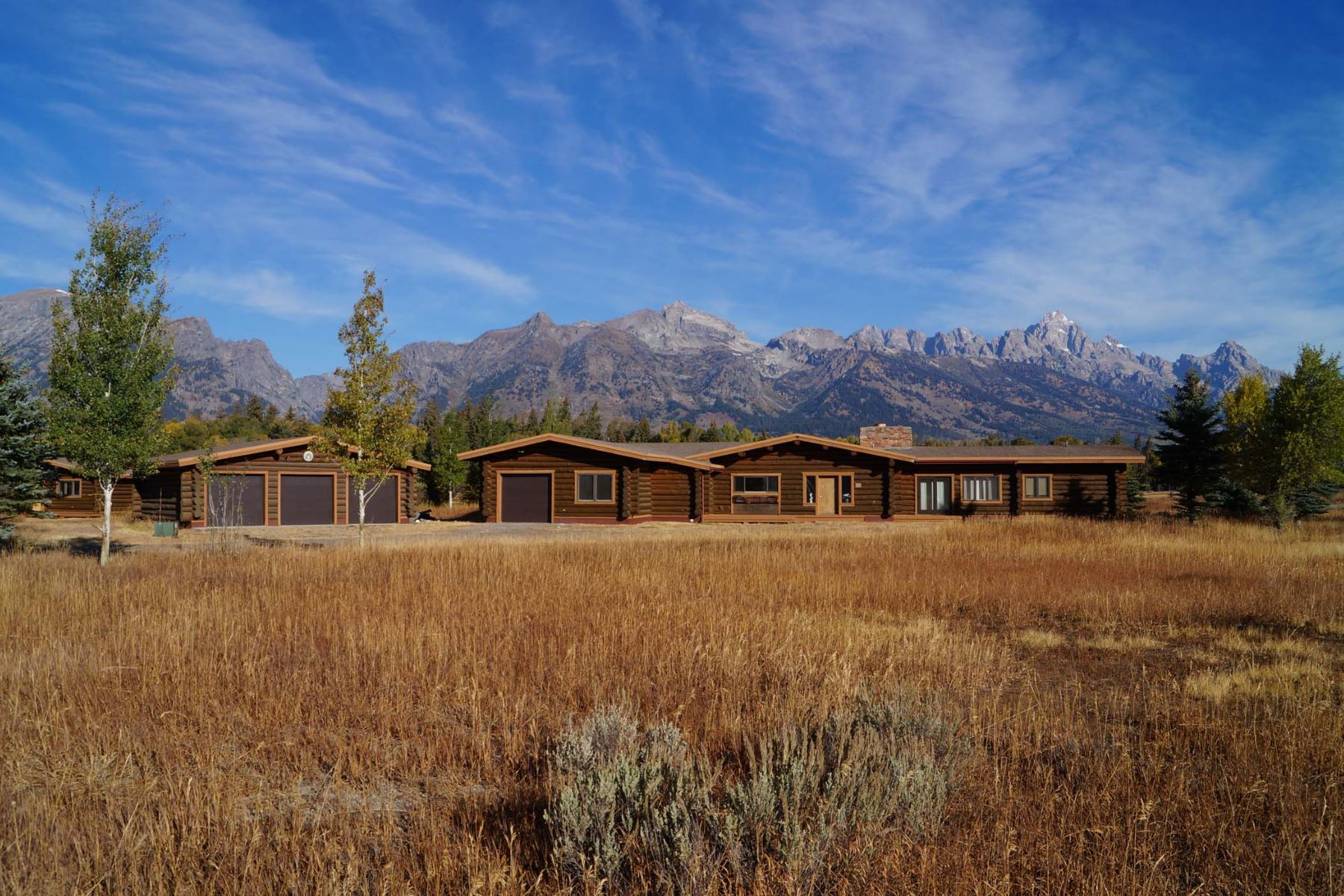 Single Family Home for Sale at Log home with stunning Teton Range views 855 E Glacier Road Jackson, Wyoming 83001 United States