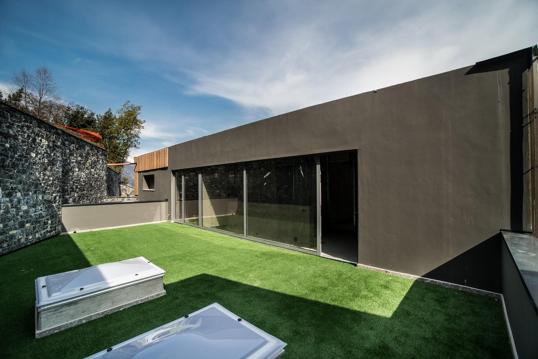 Additional photo for property listing at Prestigious modern villa with private swimming pool and magnificent Lake views Laglio Laglio, Como 22010 Italie