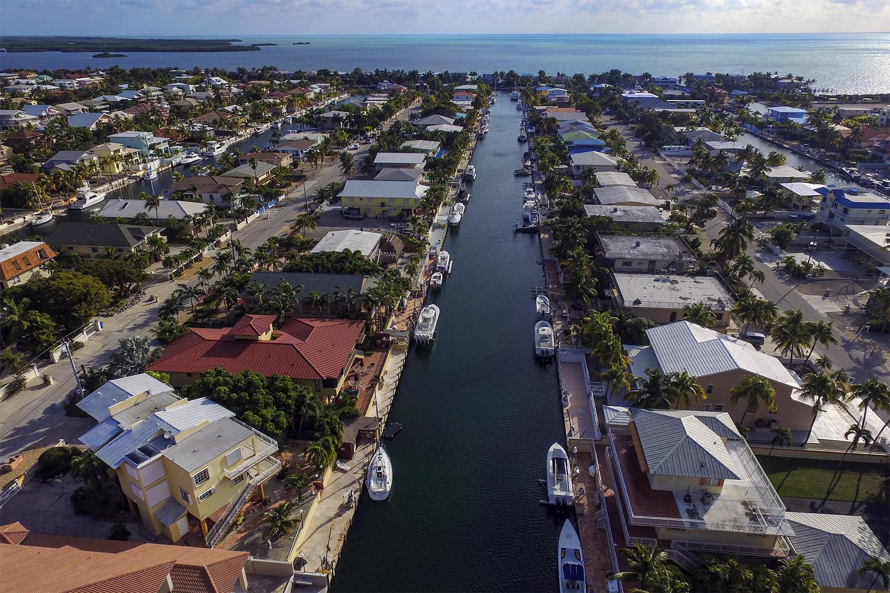 Nhà ở nhiều gia đình vì Bán tại Port Largo Waterfront Duplex 263 Saint Thomas Ave Key Largo, Florida, 33037 Hoa Kỳ