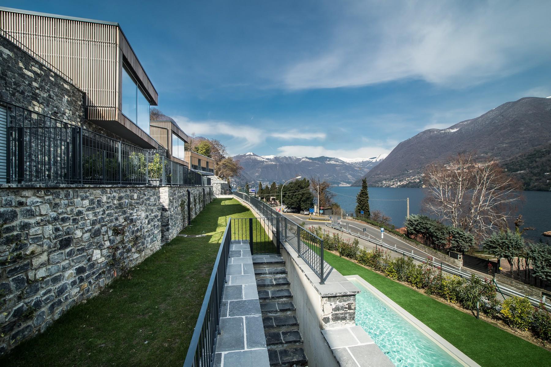 Additional photo for property listing at Prestigious modern villa with private swimming pool and magnificent Lake views Laglio Laglio, Como 22010 Italien