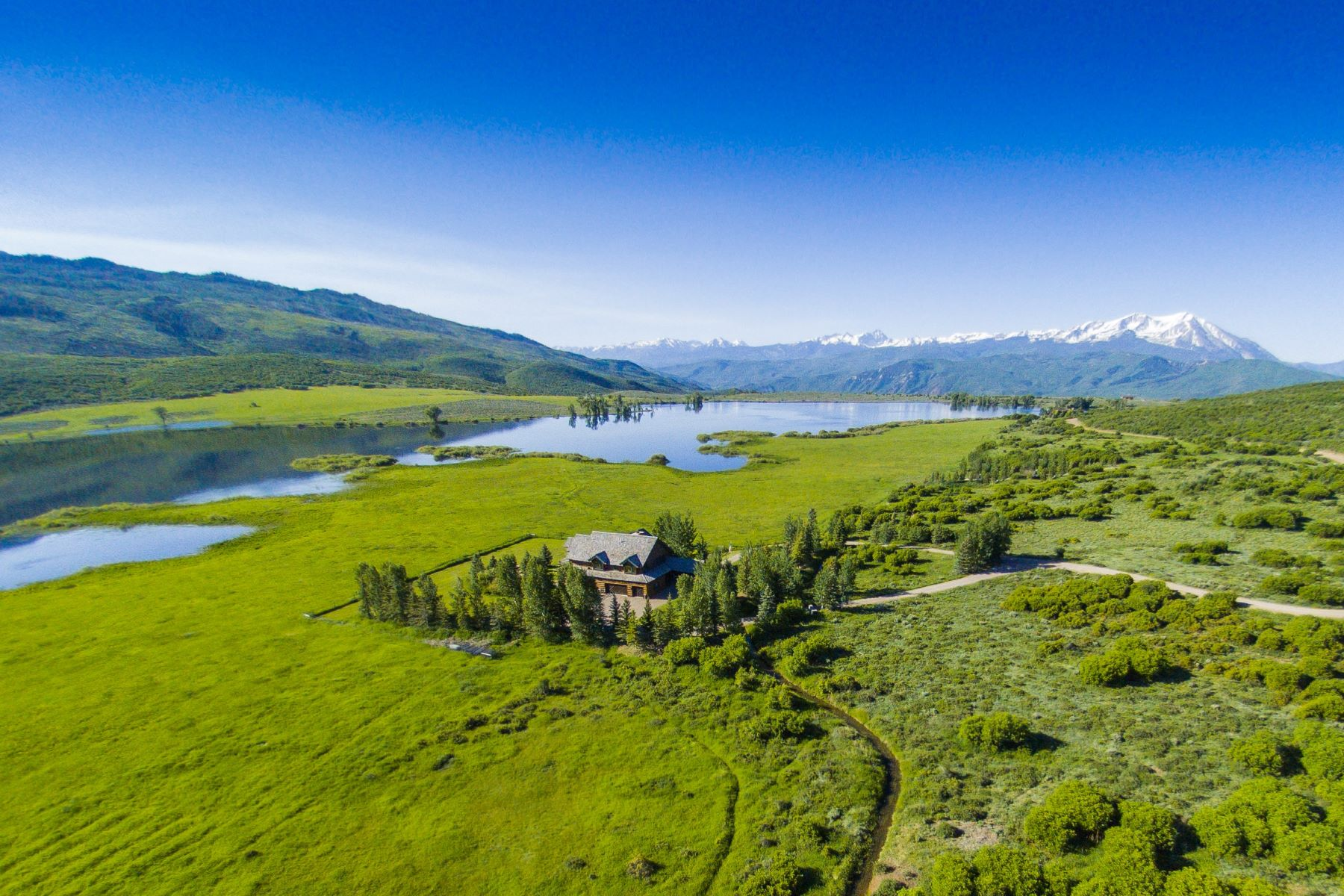 Single Family Home for Sale at Majestic Log Home on Spring Park Reservoir! 4930 Upper Cattle Road Carbondale, Colorado, 81623 United States