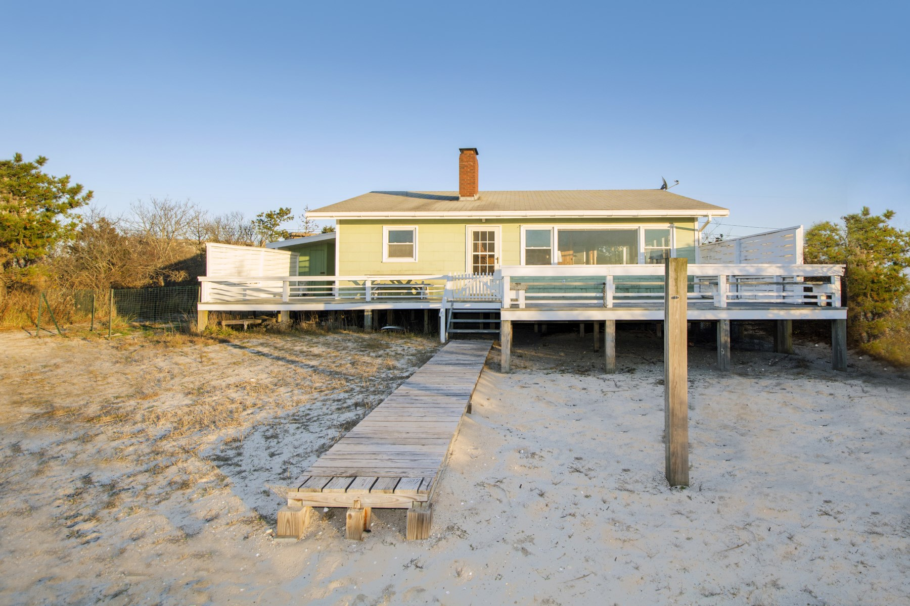 Single Family Home for Sale at Bay Front Beach Bungalow on Flying Point 9 Burnett Cove Road Water Mill, New York 11976 United States